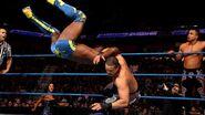 Epico and Primo puts Kingston onto the mat