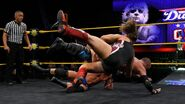 Pete Dunne and Roderick Strong puts Young on the mat
