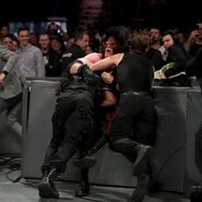 Ambrose and Rollins spear Kane through the barricade