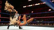 Natalya drives Flair to the canvas