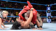 Shinsuke locks Orton in a submission hold