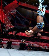 Ambrose suplex Kingston off the turnbuckle