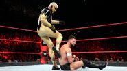 Goldust kick behind Balor