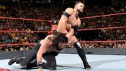Balor arm-locked on Samson