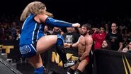 Kassius Ohno big boot to Gargano outside of the ring