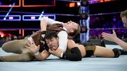Gallagher puts Itami in a submission lock