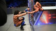 Mahal stretching both Roode arm and leg