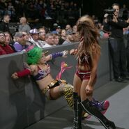 Emma put Asuka onto the barricade