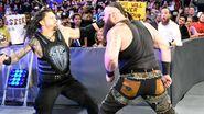 Roman-Reigns punches Braun-Strowman