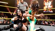 Bayley traping Paige