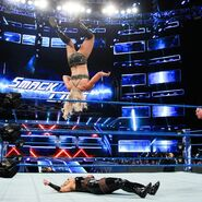 Charlotte scores with a moonsault shortly