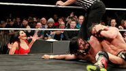 Vega distraction allows Andrade Almas the opportunity to rake Johnny Gargano's eyes