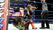 Naomi gettin stomp by Natalya