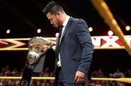 Hideo-Itami holding the NXT Championship