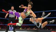 Bayley takes lana down to the mat