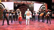Zelina Vega and a masked mariachi band accompany NXT Champion Andrade Almas to the ring
