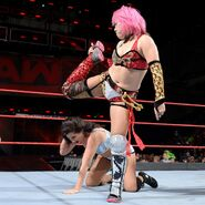 Asuka back kicking her opponent