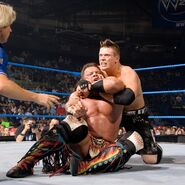 The-Miz locking Tanaka in headlock