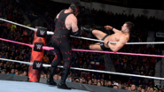 Balor kick Kane from the side apron