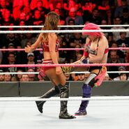 Asuka strikes with some stinging kicks