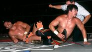 Chavo-Guerrero in submission by Eddie-Guerrero