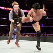 Gallagher kicked to the gut by Itami