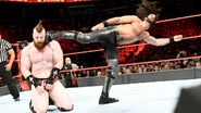 Rollins superkick Sheamus