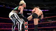 Neville delivers another punishing kick to Amore