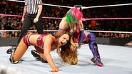Asuka trapping down Emma