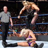 Natalya stepping onto Charlotte behind
