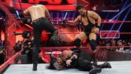 Axel Dallas beaten down Roman-Reigns