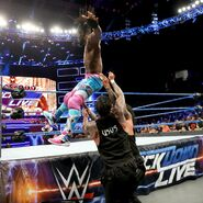 Kofi-Kingston fall onto The-Usos