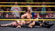 Adam-Cole beaten Eric-Young