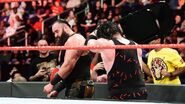 Kane tattoos Strowman with a steel chair