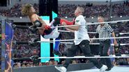 Styles stops Shane-McMahon momentum with a boot to the chest