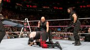 Ambrose Rollins and Angle clear the ring with wicked swings of the steel chairs