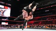 Braun slammed Brock on the mat