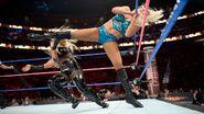 Charlotte strike a kick to Natalya