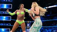 Naomi battling Carmella