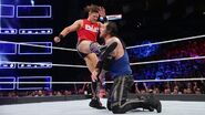The Miz looks to soften his opponent with powerful kicks