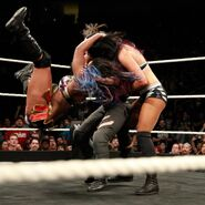 Ember Moon soars the air and obliterates Royce and Cross