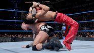 Orton inverted-headlock-backbreaker on Shinsuke