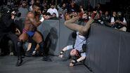 Alexander toss Gallagher onto the barricade