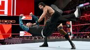 Mahal clothesline Jeff down to the mat