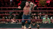 Cena delivering a attitude adjustment to Reigns