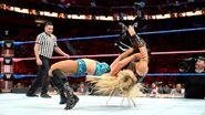 Charlotte drops Natalya onto the mat