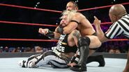 Neville putting Amore in headlock