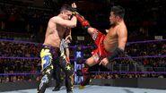 Tozawa sends a kicks at Perkins