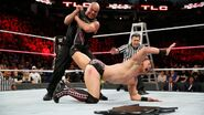 Angle recovers and traps Miz in the Ankle Lock