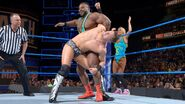 Big E slapping behind The Miz